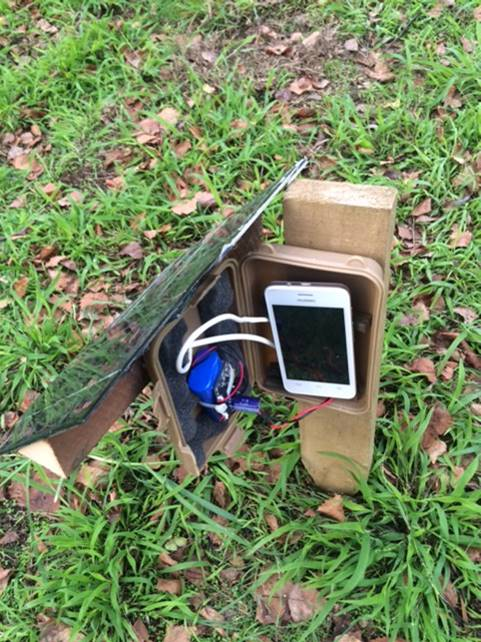 Smart phone in water proof container with opening at bottom for sound recording
