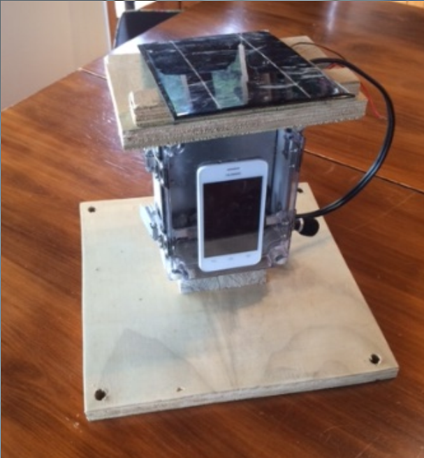 A prototype Cacophonometer including solar panel, waterproof enclosure, mic, speaker, and Android phone.